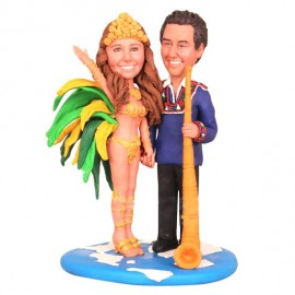 Couple in Traditional Dress of Brazil and Switzerland Wedding Cake Toppers