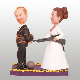 Bride Pushing Groom to the Alter with Shoot Gun Wedding Cake Toppers