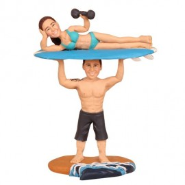 Groom Holding Bride Up on Surfboard Beach Cake Toppers