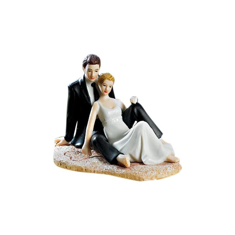 Bride And Groom Sitting On The Beach Wedding Cake Toppers